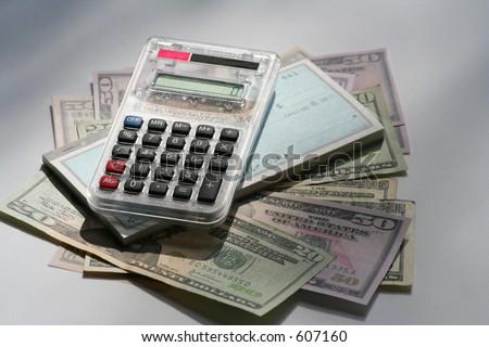 calculator, US money and checkbook - stock photo