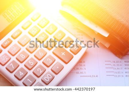 calculator,wallet,coin, Book bank statement on wooden floor - stock photo
