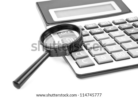 Calculator with a magnifying glass on a white background - stock photo