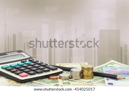 Calculator with coin ,pencil on money banknotes Euro and Dollars, the charts on display ,concept of business planning and finance and savings - stock photo