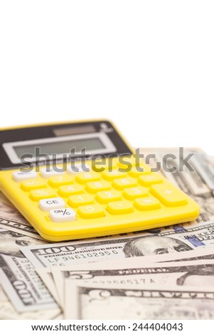 Calculator with dollars isolated on white - stock photo