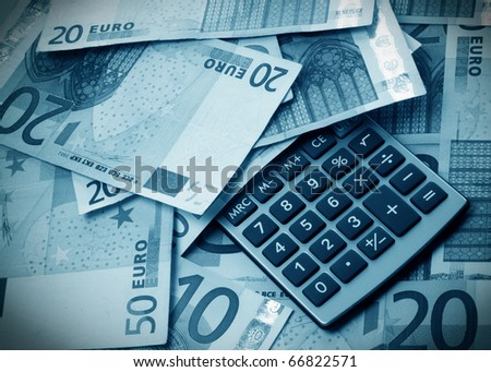 Calculator with money - stock photo