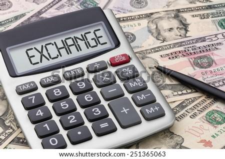 Calculator with money - Exchange - stock photo