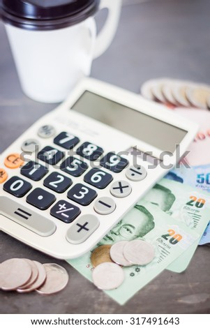 Calculator with money on grey background, stock photo - stock photo