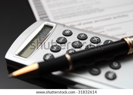 calculator with pen - stock photo