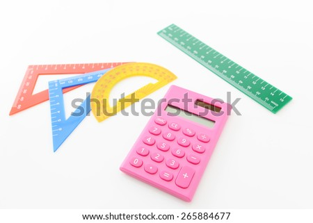 Calculator with rulers - stock photo