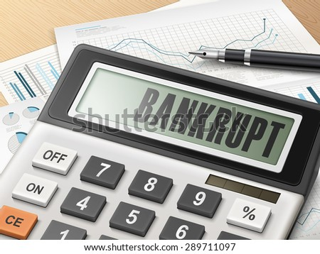 calculator with the word bankrupt on the display - stock photo