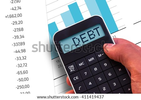 Calculator with the word Debt on the display and banknotes background - stock photo