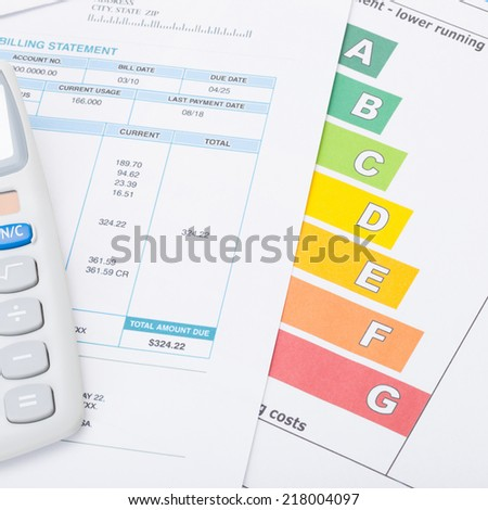 Calculator with utility bill and energy rating chart - 1 to 1 ratio - stock photo