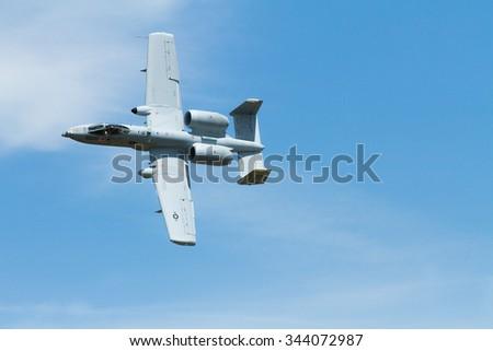 CALDWELL, IDAHO - JUNE 25, 2011: A-10 banked while in flight in caldwell Idaho - stock photo