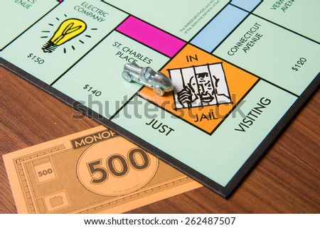 CALDWELL, IDAHO/USA - MARCH 16, 2015: Car leaving jail with a 500 note on the table implying bribery - stock photo