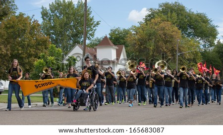 CALDWELL, IDAHO/USA - SEPTEMBER 27: The high school band plays music at the Caldwell High School Homecoming parade on September 27, 2013  - stock photo