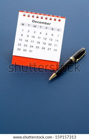 Calendar December close up with blue background - stock photo