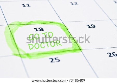 Calendar mark  with go to doctor - stock photo