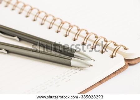Calendar notebook with pen and pencil, selective focus - stock photo