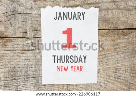 Calendar on old wooden wall. 1 January. - stock photo