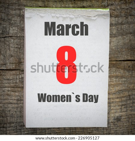 Calendar on old wooden wall. 8 March Women`s Day - stock photo