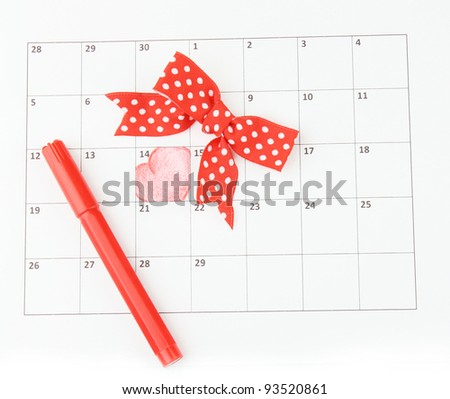 Calendar page with hearts, marker and bow on St.Valentines Day - stock photo