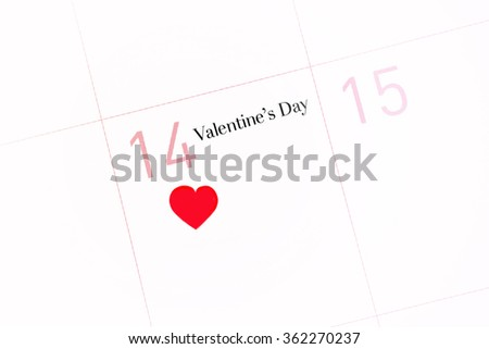 Calendar page with the red heart on February 14 of Saint Valentines day. - stock photo