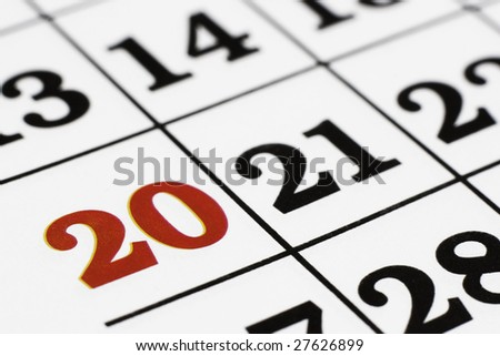 Calender over white background,macro - stock photo