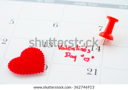 Calender page with a detail of the valentine day with red heart. - stock photo