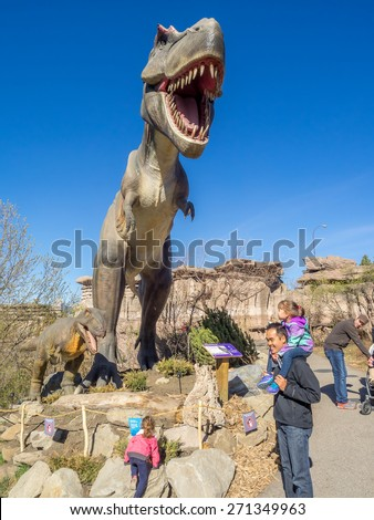 CALGARY, CANADA - APRIL 17: Animatronic Dinosaurs exhibits at the  Prehistoric Park section of the Calgary Zoo on April 17, 2015. The Prehistoric Park section recalls Alberta's dinosaur heritage. - stock photo