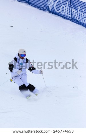 CALGARY CANADA JAN 3 2015. FIS Freestyle Ski World Cup, Winsport, Calgary Mr. Marc-Antonie Gagnon from Canada at the Mogul Free Style World Cup on race day.  - stock photo