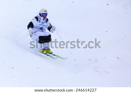 CALGARY CANADA JAN 2 2015. FIS Freestyle Ski World Cup, Winsport, Calgary Mr. Marc-Antonie Gagnon  from Canada  at the Mogul Free Style World Cup on race day.  - stock photo