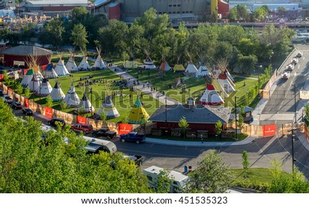 CALGARY, CANADA - JULY 8: Panoramic view of the Indian Village at the Calgary Stampede on July 8, 2016 in Calgary, Alberta. The Indian Village represents First Nations people at the Calgary Stampede. - stock photo