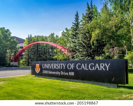 CALGARY, CANADA - JULY 13: The University of Calgary entrance sign and arch on July 13, 2014 in Calgary, Alberta Canada. The sign and arch are the main feature marking the entrance to campus.  - stock photo