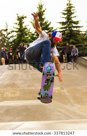CALGARY, CANADA - JUN 21, 2015: Athletes have a friendly skateboard  Show Off  in Calgary. California law requires anyone under the age of 18 to wear a helmet while riding a skateboard. - stock photo