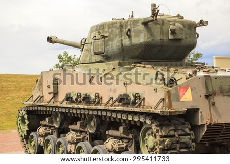 CALGARY CANADA-JUN 13: Exhibits outside the Military Museums  in Calgary, Alberta Canada. It is made of museums dedicated to representing Canada's navy, army, and air force.  Sherman tank on display  - stock photo