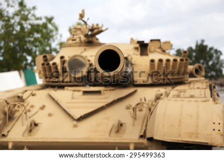 "CALGARY CANADA JUN 13 2015:  The Military Museum organized ""Summer Skirmish"" event where an unidentified soldier is seen  in a historical Reenactment Battle. T-72 main battle tank on display. - stock photo"