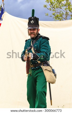 """CALGARY CANADA JUN 13 2015: The Military Museum organized """"Summer Skirmish"""" event where an unidentified soldier is seen in a historical Reenactment Battle.  - stock photo"""