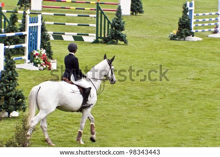 CALGARY, CANADA-JUN 9 : Unknown rider on a horse during 2005, INTERNATIONAL Race on Jun 09 , 2005  at Calgary Show Jumping Horse Race Course in Calgary - stock photo