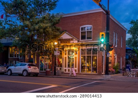 CALGARY, CANADA - JUNE 12: Facade of a Starbucks in the Kensington on June 12, 2015. It is known for trendy restaurants, nightlife, galleries and upscale shops, all popular with locals and tourists. - stock photo
