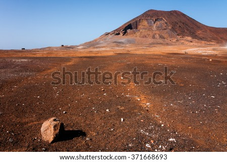 Calhau crater, Cape Verde - Sao Vicente Island. Single  rock, Martian like dry red ground surface - stock photo