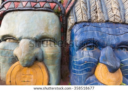 CALI, COLOMBIA, MARCH 6: Closeup of sculptures bas relief depicting the Inca and Indian indigenous lifestyle in the mountain of Cali, Colombia 2015 - stock photo