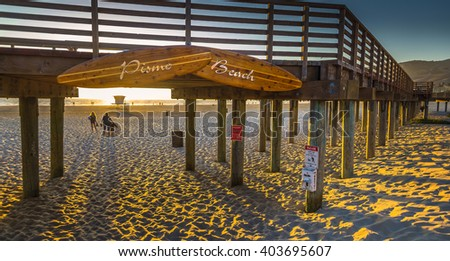 California Pismo beach sunset boardwalk shadows summer evening - stock photo