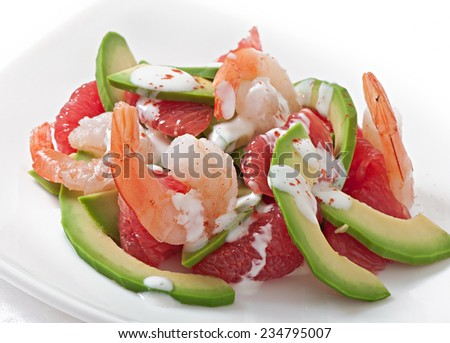 California salad - a mix of avocado, grapefruit and shrimp, seasoned with cayenne pepper yogurt - stock photo