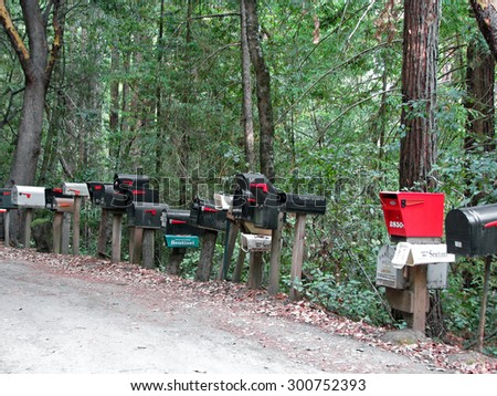 CALIFORNIA STATE ROUTE 236 , CA - NOVEMBER 15, 2012:   Mailboxes Lined Up On Side of Rural Road   - stock photo