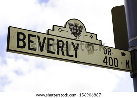 CALIFORNIA, USA - SEPTEMBER 16: Beverly Hills road sign on September 16, 2013 in Beverly Hills, California USA. The affluent city has a population of 34,109 at the 2010 census. - stock photo