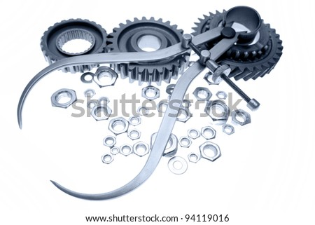 Calipers, nuts and cogwheels on plain background - stock photo