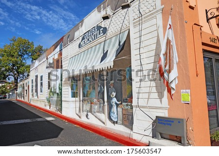CALISTOGA, CALIFORNIA - OCTOBER 6 2012: Trompe l'oeil mural by Carlo Marchiori on the side of a building. Historic Calistoga is a popular tourist stop at the north end of Napa Valley wine country. - stock photo