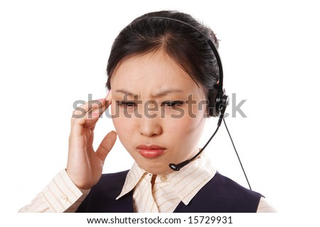 Call center operator wearing business suit standing on white with an annoyed expression. - stock photo