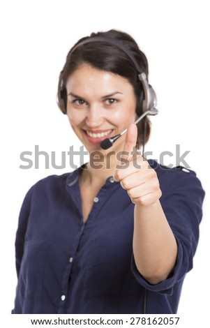 Call center operator woman hand with thumbs up. Posing and smiling with headset on a white background - stock photo