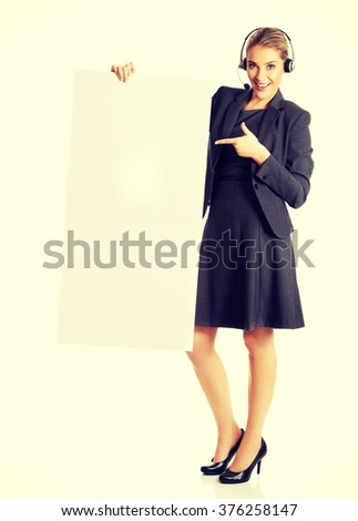 Call center woman holding empty blank - stock photo
