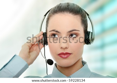 Call center woman with headset - stock photo