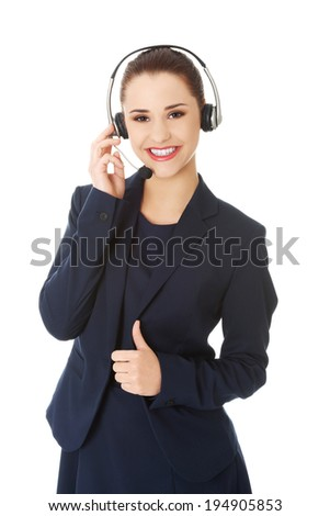 Call center woman with headset gesturing OK. - stock photo