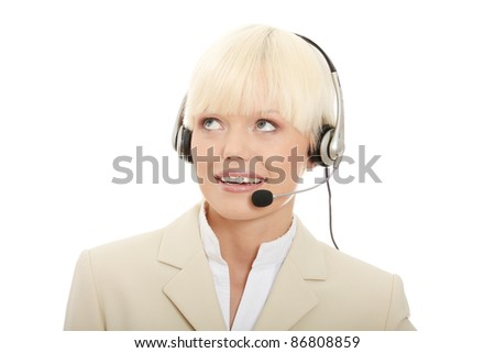 Call center woman with headset looking up right corner. Isolated on white background. - stock photo
